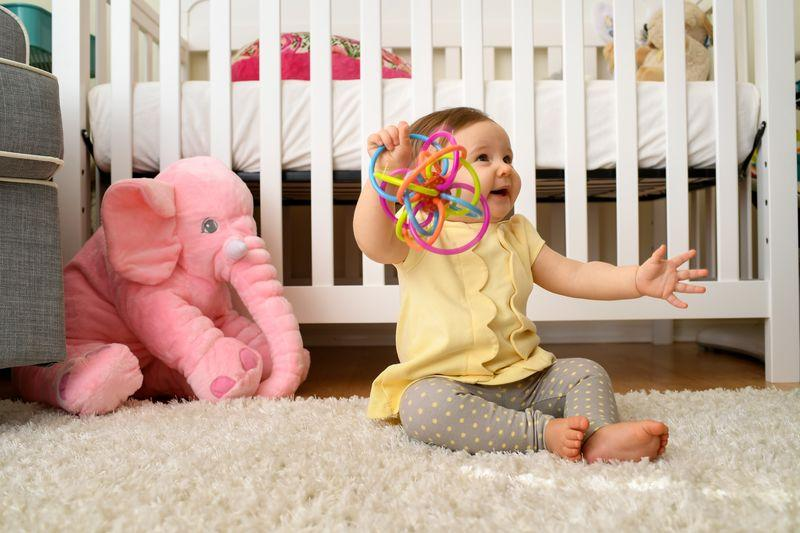 Baby plays with her toy at home