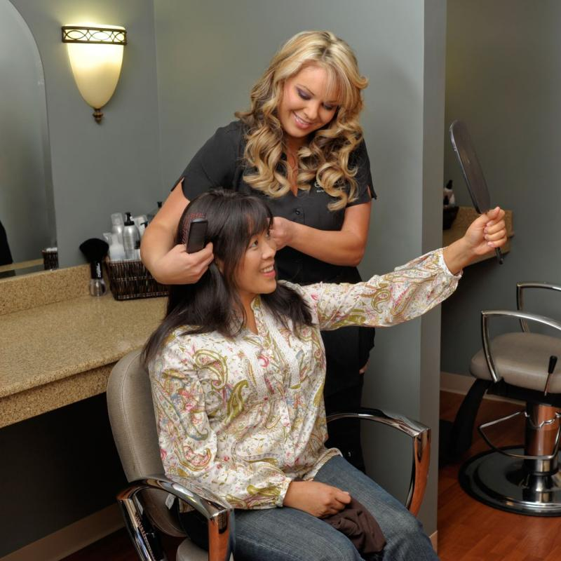 Chemo patient with hairdresser at hair salon