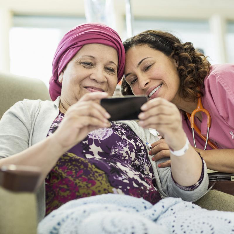A young nurse and her female cancer patient taking a sweet selfie at Adventist Health System