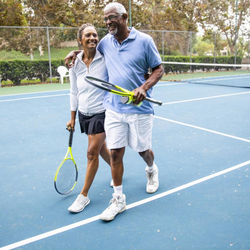 Active Older Adults Playing Tennis